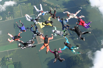 16 skydivers in freefall