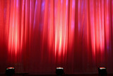 spot lights on red curtain poster