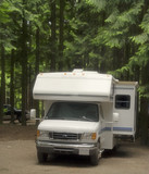motorhome on a campground with slide-out poster