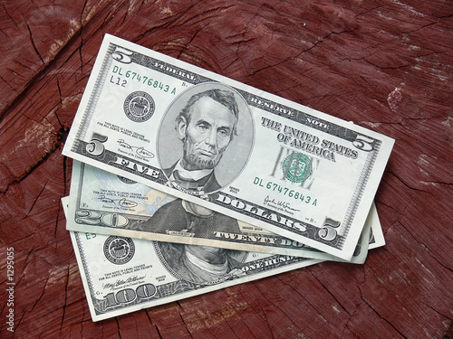 dollar notes against wooden background
