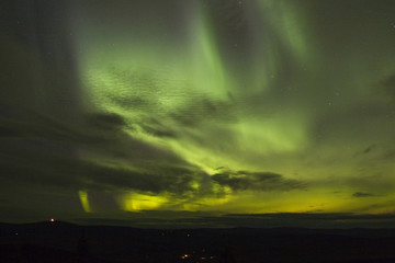 northern lights under clouds