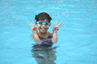 girl in the pool showing victory sign