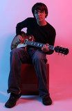 young guy and guitar poster