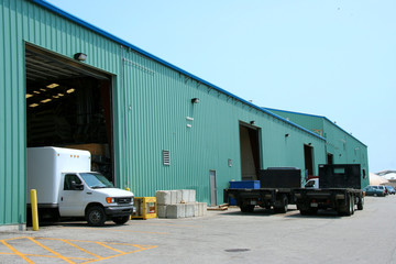 factory with trucks