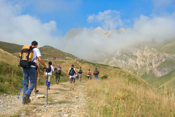 people hiking in the mountain korab