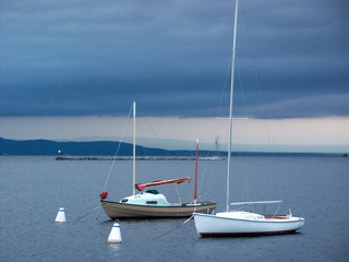 sailboats in the gray