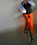 unicyclist on unicycle on stage poster