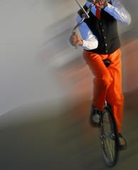 unicyclist on unicycle on stage