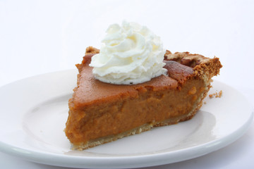a tasty slice of pie with whipped cream