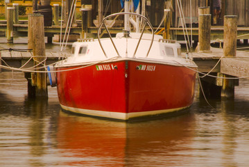 red docked sailboat