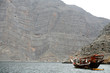 dhow by cliff, musandam peninsula oman