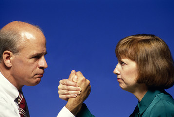 man and woman arm wrestle for control