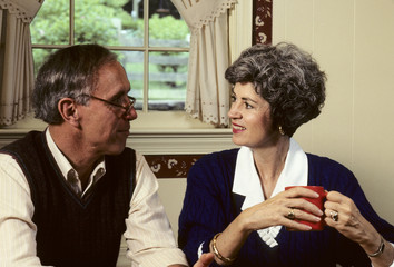senior couple talking at home