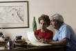 retired couple work on financial records