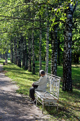 the elderly woman on a bench in park