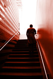man climbing on the stairs poster