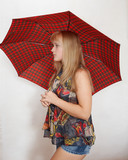young woman with umbrella poster