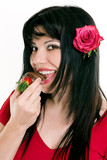 female eating fresh strawberries in chocolate poster