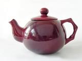red ceramic tea-pot poster