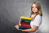 girl carrying books poster