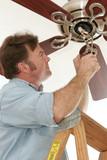 electrician installing ceiling fan poster