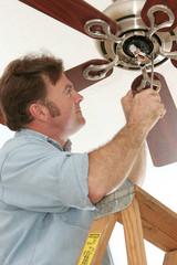electrician installing ceiling fan