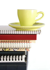 coffee cup on pile of files