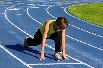 woman exercising on a blue racetrack