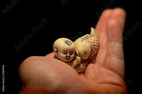 netsuke small boy (karako) and fish