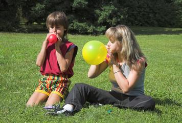 boy and girl cheats varicolored air-ball