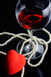 wine glass and a red heart