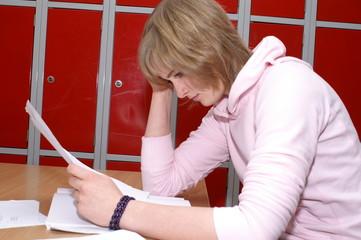 a schoolgirl doing homework during the break