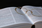glasses on book page poster