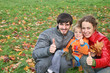 autumn family with finger ok
