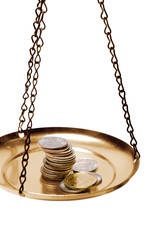 money on a balance scale