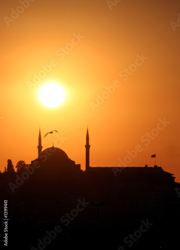 orange sunset at istanbul with mosque