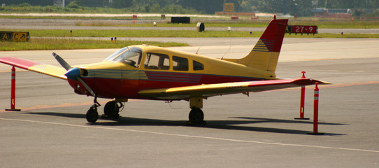 red and yellow plane