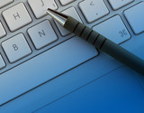 pen on laptop poster