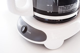 automatic drip coffee maker on white background poster