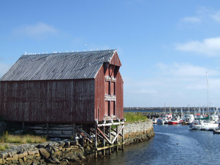 small harbor and wooden warehouse