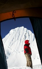 climber and alpamayo peak from the tent