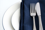 place setting with blue napkin poster