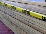 stack of two by fours caution poster