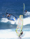 three windsurfers, one horizontal