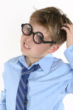 school student in comical spectacles and a confusedl expression poster
