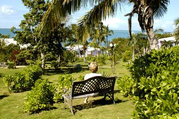 lady on a bench, bahamas
