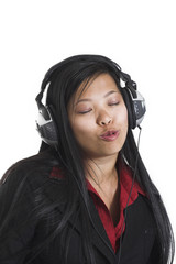 woman listening to music over white background