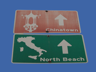 chinatown and little italy direction sign