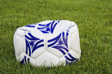 flat white and blue soccer ball on grass