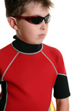 boy in wetsuit and sunglasses poster